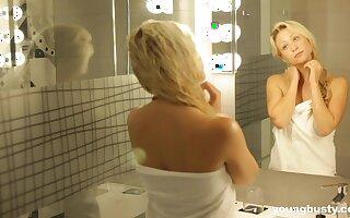 Torrid busty blondie Gabi Gold just loves teasing her wet pussy sensually
