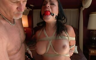 Ropes are holding Ashli Ames in place while her master is playing