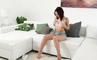 Desirable brunette Mina spreads her wings with respect to masturbate on the divan