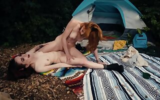 Redhead took show one's age to forest to fuck will not hear of by the caravan site