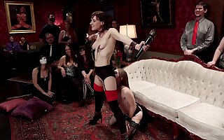 Alice March and Audrey Holiday are among an obstacle subs at a BDSM party
